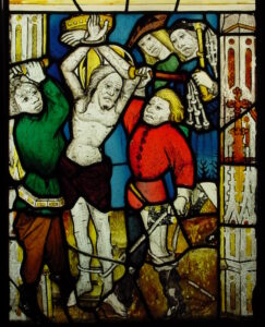 A panel from Passion window showing the flaying of Christ after restoration.