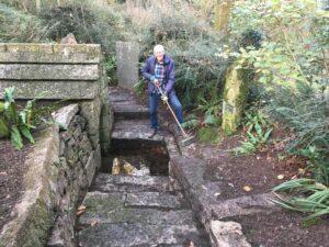 Brian Oldham , President Liskeard OCS cleaning St Keynes Holy Well - Nov 2020